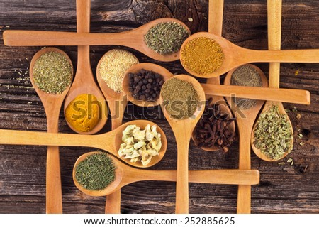Wooden spoons with spices on an old wood - stock photo