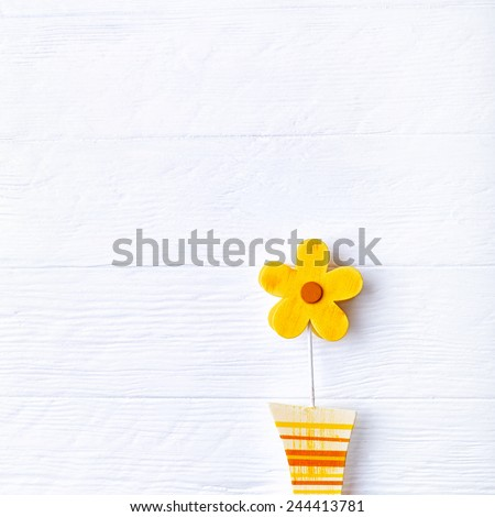 Wooden spring decoration on a painted surface - stock photo