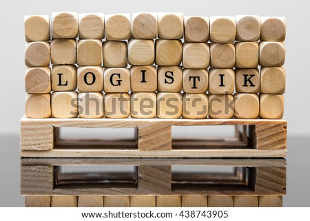 wooden squares with the german inscription logistik, which means logistic, on a palett