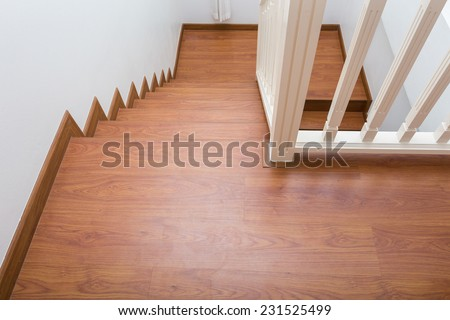 wooden staircase made from laminate wood in white modern house - stock photo