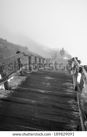 Wooden staircase on the foggy mountain of Puy de Sancy, Auvergne, France - stock photo