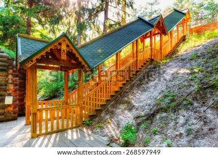 Wooden staircase with yellow railing and tegular roof - stock photo