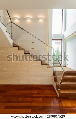 Wooden stairs and parquet in luxury apartment - stock photo