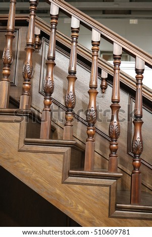 Wooden stairs and railings with balusters