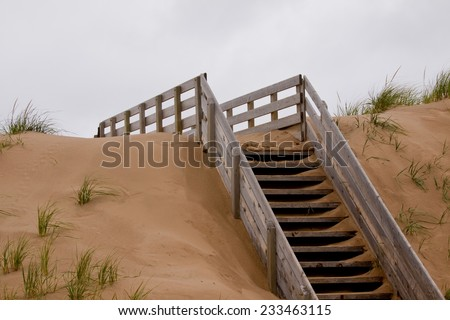 Wooden stairs going up over the dunes to the beach. Prince Edward Island National Park, on the north shore of Prince Edward Island, Canada - stock photo