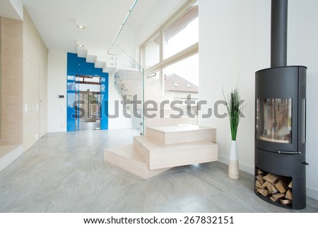 Wooden stairs in entrance hall leading to the first floor - stock photo