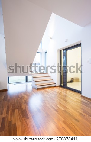 Wooden stairs leading on the first floor in big modern house