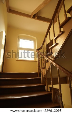 Wooden stairs of a apartments building - stock photo