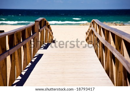 Wooden stairs on deserted beach dunes in Tarifa, Spain