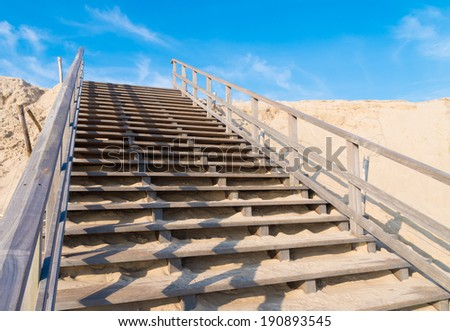 wooden stairs over a sand dune on the 2nd maasvlakte in Rotterdam. This area, opened in May 2013, means an expansion of the harbor with 20 percent - stock photo