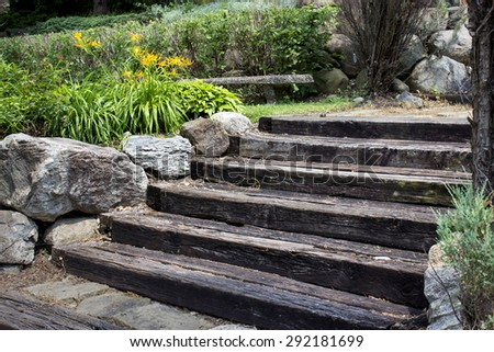 wooden stairs with boulders and golden flowers - stock photo