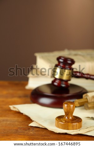 Wooden stamp, gavel and old papers on wooden table