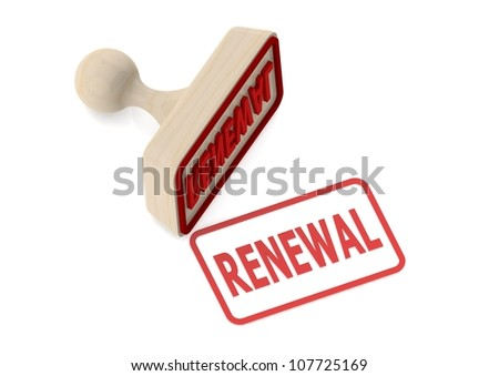 Wooden stamp with renewal word - stock photo