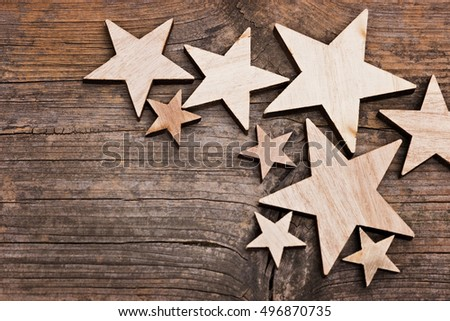 Wooden stars on a wooden table with copy space