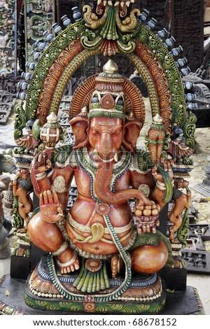 wooden statue of hindu god ganesh. Found in Mumbai, India. - stock photo