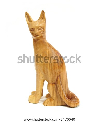 wooden statuette of cat over white background - stock photo