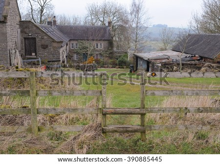 Wooden Stile Leading to a Farm near the Rural Village of Tissington within the Peak District National Park, Derbyshire, England, UK