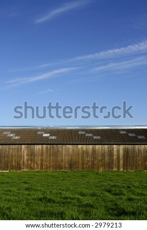 Wooden storehouse in the countryside, with a blue sky background