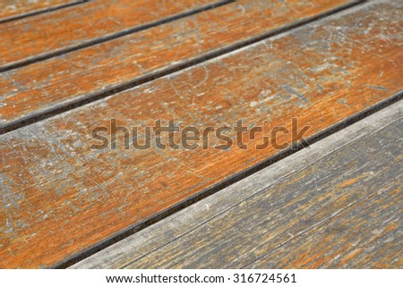 Wooden surface of outdoors table - stock photo