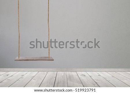 wooden swing and wood floor on gray concrete of wall background.