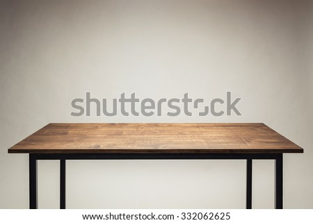 Wooden table against gray background. - stock photo