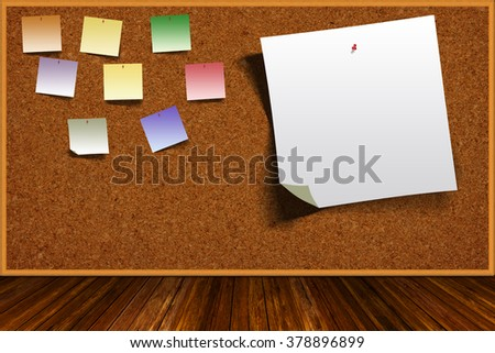 Wooden table and background cork board with colorful pinned notes and copy space.