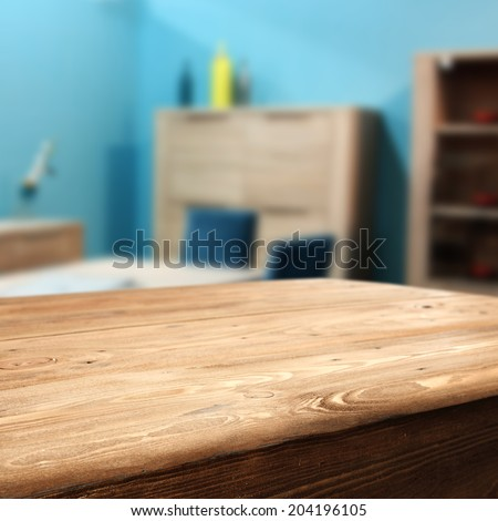 wooden table and blue wall  - stock photo