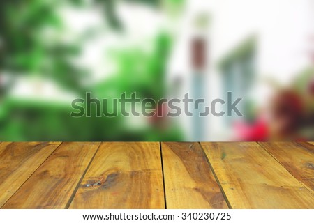 Wooden table and blurred image house background - stock photo