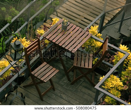 Wooden table and chair in the garden