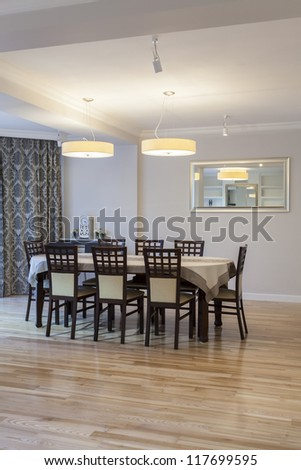 Wooden table and chairs in dining room - stock photo