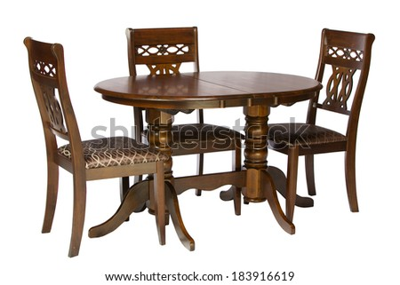Wooden table and chairs isolated on white background - stock photo