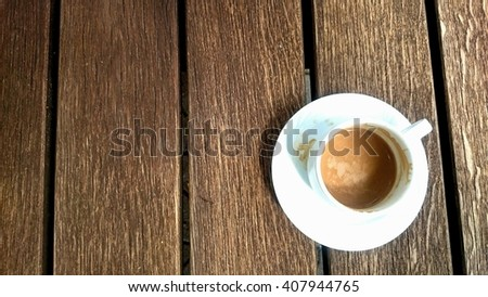 Wooden table and cup of coffee