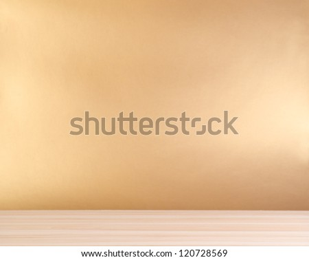 wooden table and golden background - stock photo