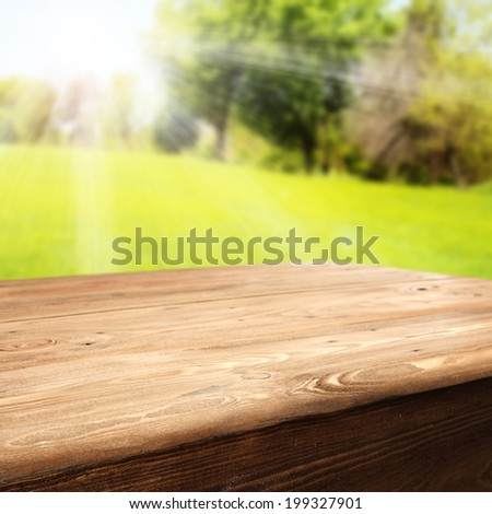 wooden table and sunset in park  - stock photo