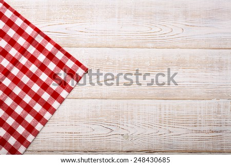 Wooden table covered with tablecloth. View from top. Empty tablecloth for product montage. Free space for products and for your text - stock photo