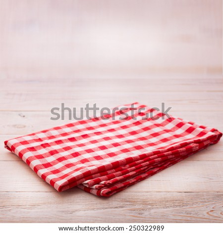 Wooden table covered with tablecloth. View from top texture wallpaper square. Unique perspectives. Empty tablecloth for product montage. Free space for products and for your text