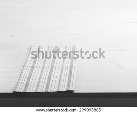 Wooden table covered with tablecloth. View from top texture wallpaper. Unique perspectives. Empty tablecloth for product montage. Free space for products and for your text. Black and white.