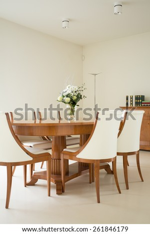 Wooden table in dining room in traditional style