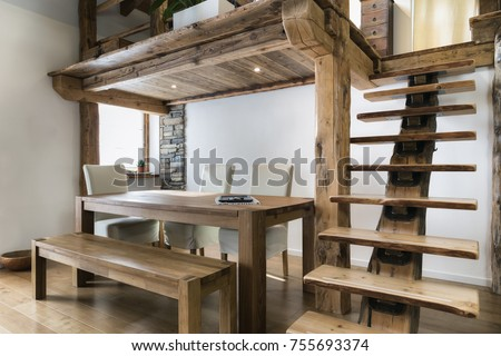 Wooden Table Dining Room Under Mezzanine Stock Photo (100% Legal ...