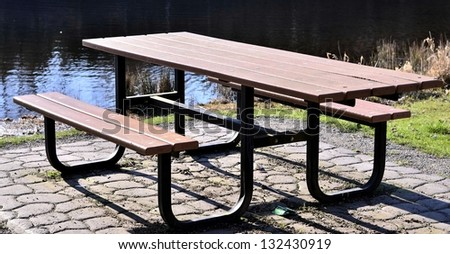Wooden table in the forest - stock photo