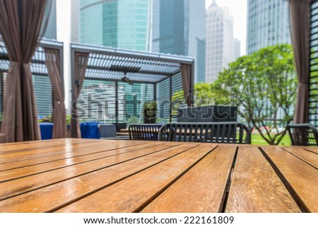 Wooden table in the outdoor coffee room - stock photo