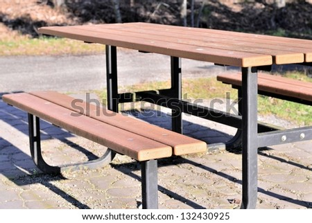 Wooden table in the park close up - stock photo