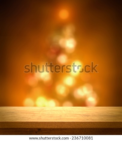 Wooden table on christmas tree bokeh background - stock photo