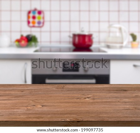 Wooden table on kitchen bench background - stock photo