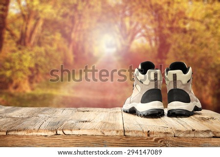 wooden table place shoes and summer sun  - stock photo