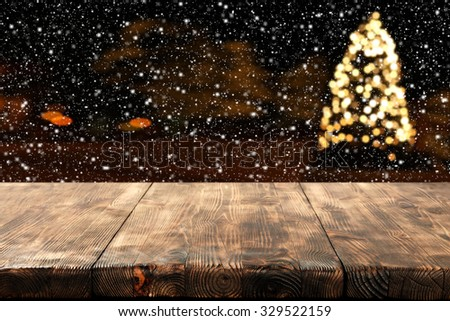 wooden table place xmas tree and snow space  - stock photo