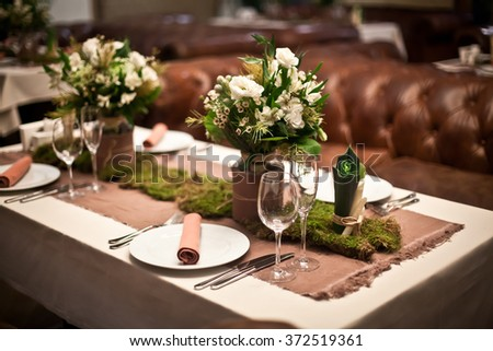 Wooden table set for holiday dinner