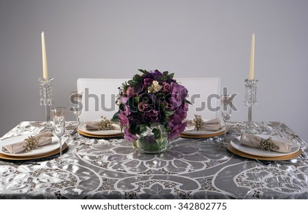 Wooden table setting and decoration for meal time - stock photo