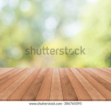 Wooden table top on blurred green background -  used for display your products - stock photo