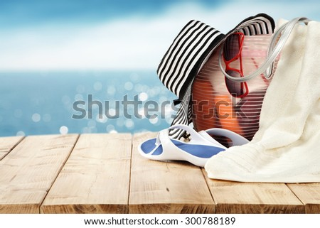 wooden table white and blue hat and white towel  - stock photo